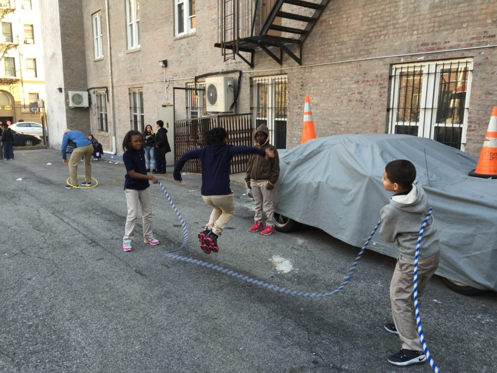 G2Kids jumping rope in the parking lot.