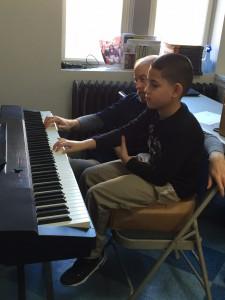 Manuel learning piano at Graffiti 2