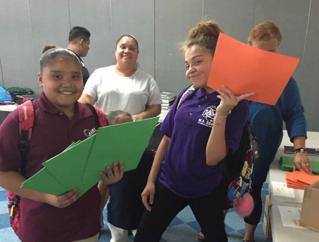 Students shopping for school supplies at our annual school supply sale