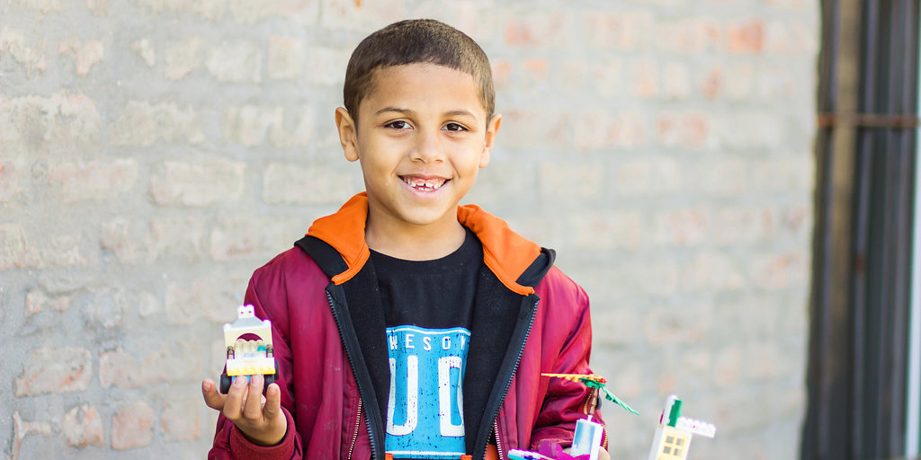 A child holding supplies
