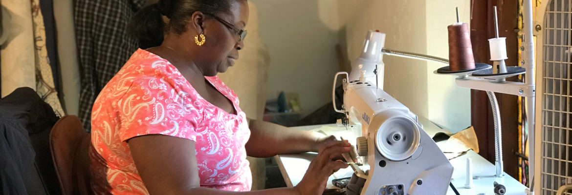 A woman sews at the G2 Work program